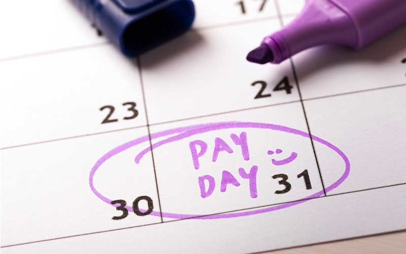 photo of a calendar with the 31st circled and labeled pay day