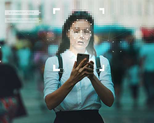 photo of a woman looking at a cellphone screen