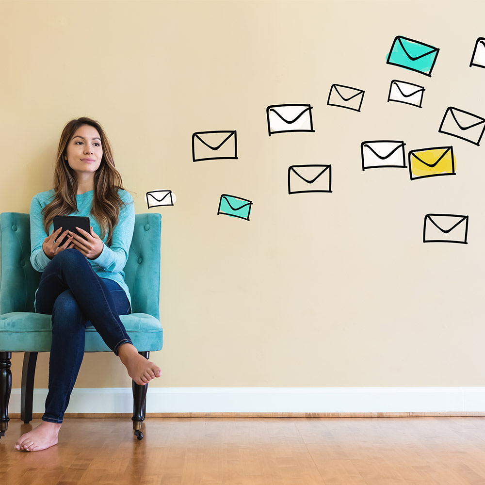 photo of a woman checking email on a couch